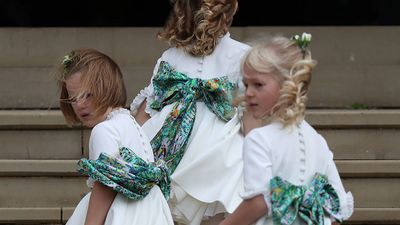 Mia Tindall acts as flower girl at the wedding of Princess Eugenie and Jack Brooksbank, fighting the windy conditions as she made her way up the stairs of St George's Chapel.