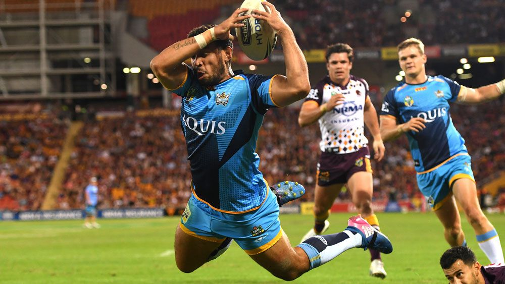 Gold Coast winger Tyronne Roberts-Davis bombs a try against Brisbane