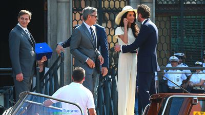 Alamuddin is greeted as the couple arrive at the city hall.