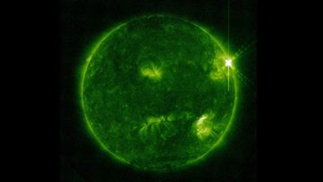 The sun pictured as a solar flare erupts from it.