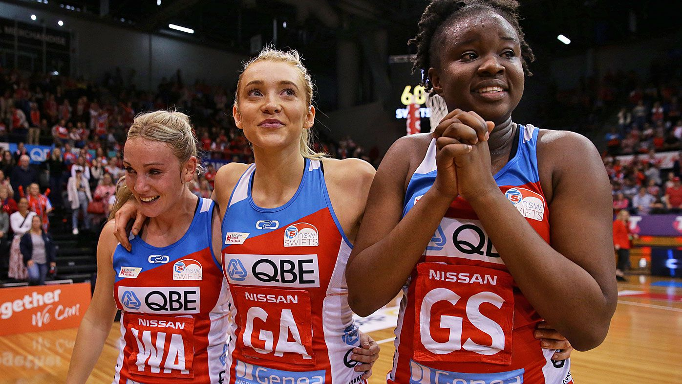 Natalie Haythornthwaite, Helen Housby and Sam Wallace of the Swifts celebrate after victory in the Super Netball Preliminary Final