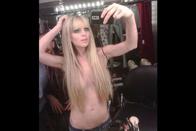 """""""I'm THAT bored,"""" Lindsay Lohan said when she uploaded this pic. Never one to let this sort of things go unnoticed, she even sent it to Perez Hilton!"""