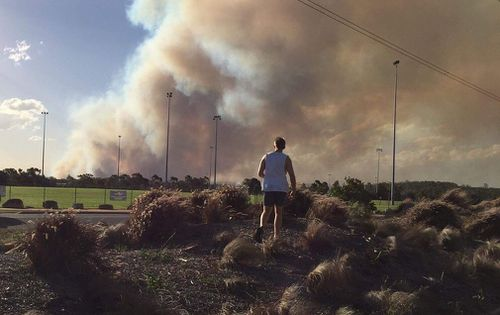 Massive plumes of smoke were seen flooding the sky as the bushfire grew in size. Picture: Matthew McOrist.