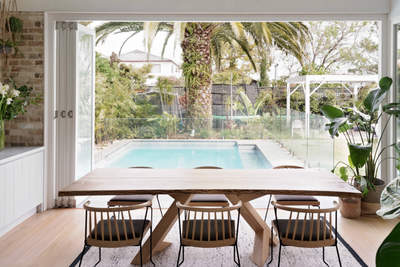 <strong>After: a bright cove with folding doors and views of the pool</strong>