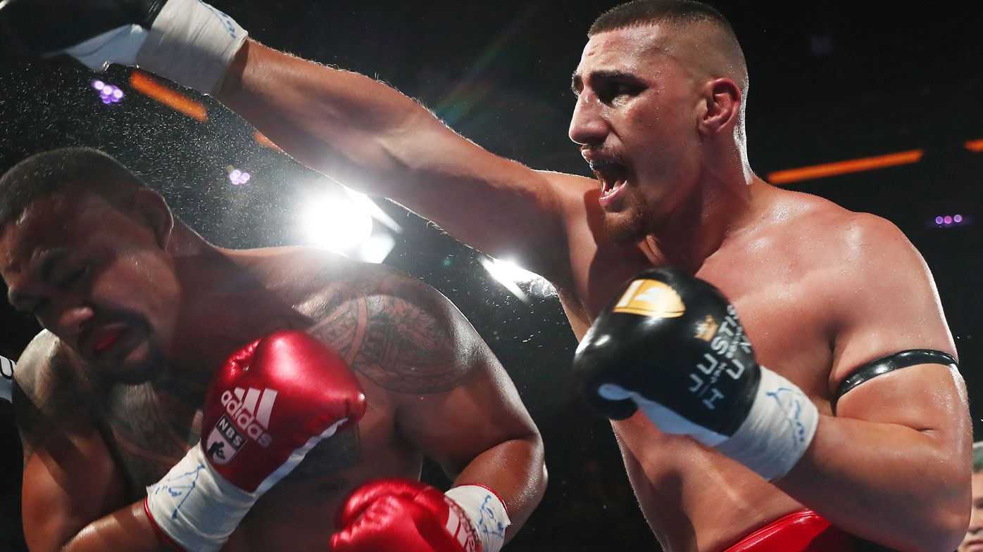Aussie giant Justis Huni makes boxing history in dream title debut