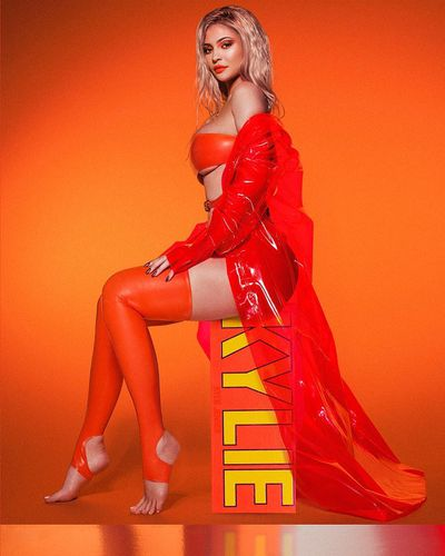 Kylie poses in a bright orange latex getup for the launch photos of her 2018 Summer Kylie Cosmetics range back in July.