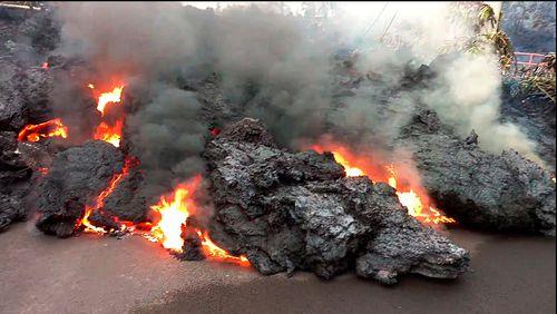 A lava flow advances down a road near Pahoa on the island of Hawaii. Picture: AP