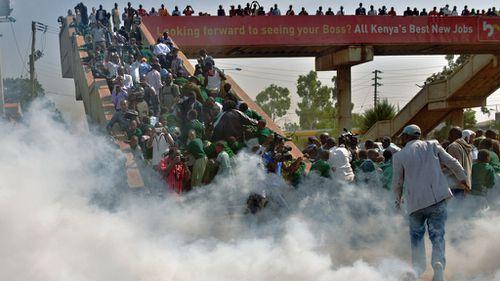 School children scramble up a bridge to escape the tear gas. (Tony Karumba/AFP/Getty Images)