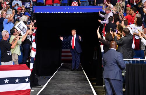President Donald Trump greets thousands of his supporters at a campaign rally.