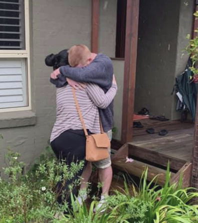 The moment the couple reunited after being cut-off by flood waters for three days.