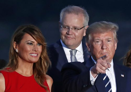US President Donald Trump, his wife Melania Trump and Australian Prime Minister scott Morrison pose for the leaders photo during the G7 summit in Biarritz, France.
