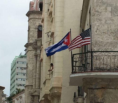 American and Cuban flags flying together. (Laura Turner)