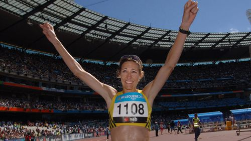 McCann celebrating winning the women's marathon in front of thousands of people. Picture: AAP