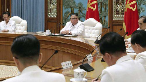Kim Jong-un attends an emergency Politburo meeting in Pyongyang, North Korea.