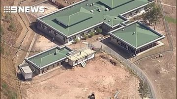 Teen inmates climb onto roof of detention centre