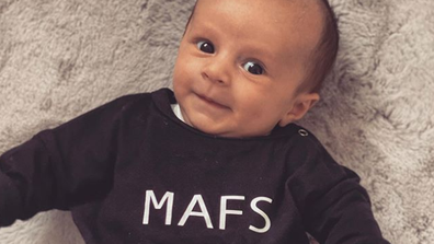 Baby Oliver Chase Merchant in a MAFS onesie.