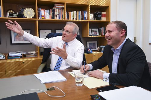 PM Morrison and new Treasurer Josh Frydenberg meet at Parliament House yesterday.