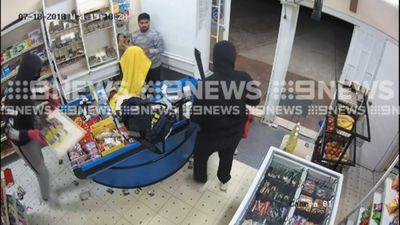 Machete-wielding robbers terrorise store worker
