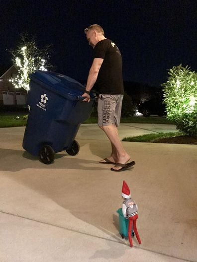 Elf on the Shelf taking out the rubbish.