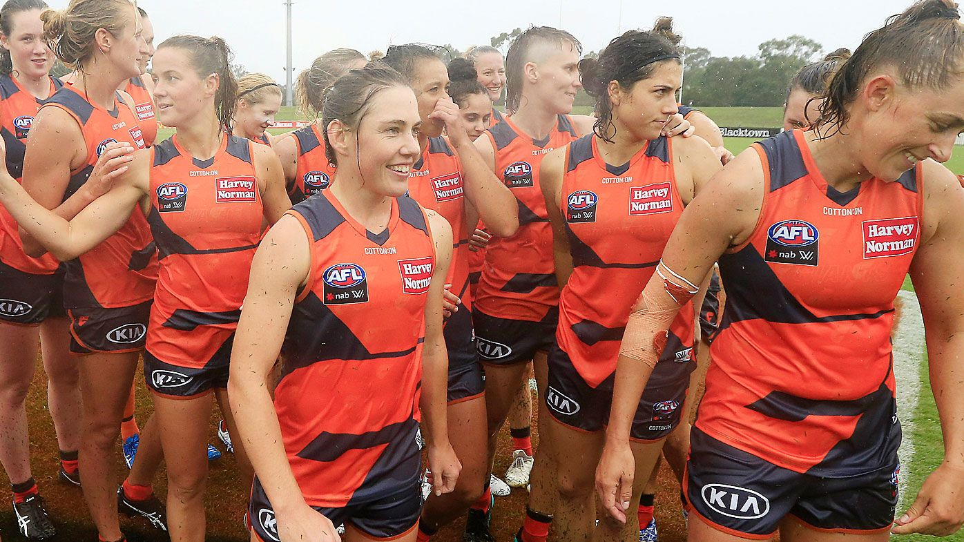 The Giants celebrate their win during the round one AFLW match