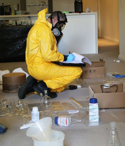 A mix of chemicals are typically used as part of the process of mixing drugs, requiring officers to take extreme precautions. (Supplied)