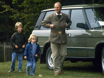 Prince Philip with grandchildren Peter and Zara Phillips