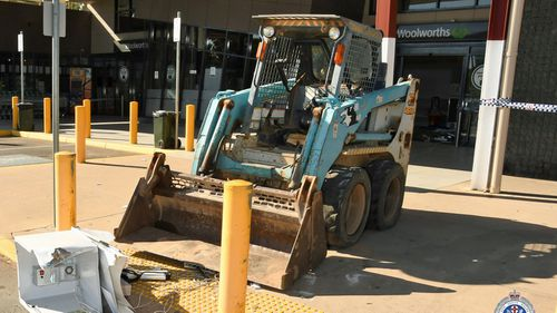 The bobcat, believed stolen, used in the robbery.