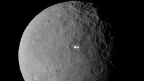 The unidentified bright spots snapped from the Dawn probe on approach to Ceres. (AAP)