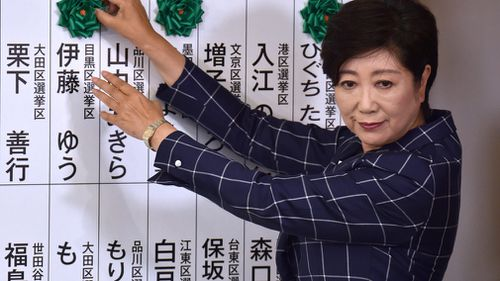 Tokyo governor Yuriko Koike has announced she's starting her own political party to challenge Mr Abe. (AFP)
