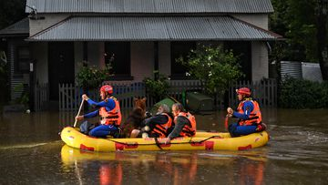 SES rescue Windsor residents as their homes become isolated and inundated as the Hawkesbury River floods.