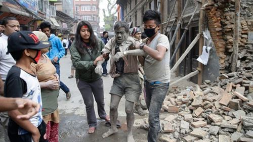 People dig through the rubble of collapsed buildings and search for survivors. (AAP)