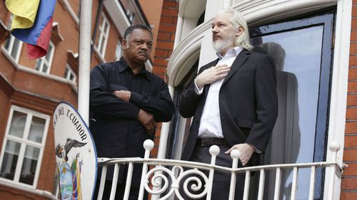 US Reverend Jesse Jackson with Julian Assange on a balcony of the Ecuadorian embassy in London.