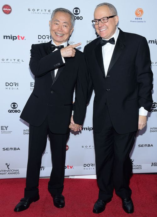 George Takei, left, and his husband Brad Altman, right, arrive at the 2015 International Emmy Awards in New York (AP)