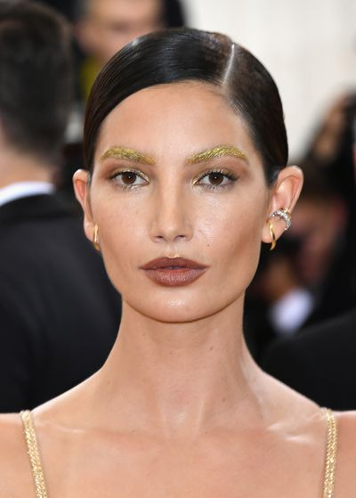 Lily Aldridge's statement glitter brows made for an otherworldly beauty statement.