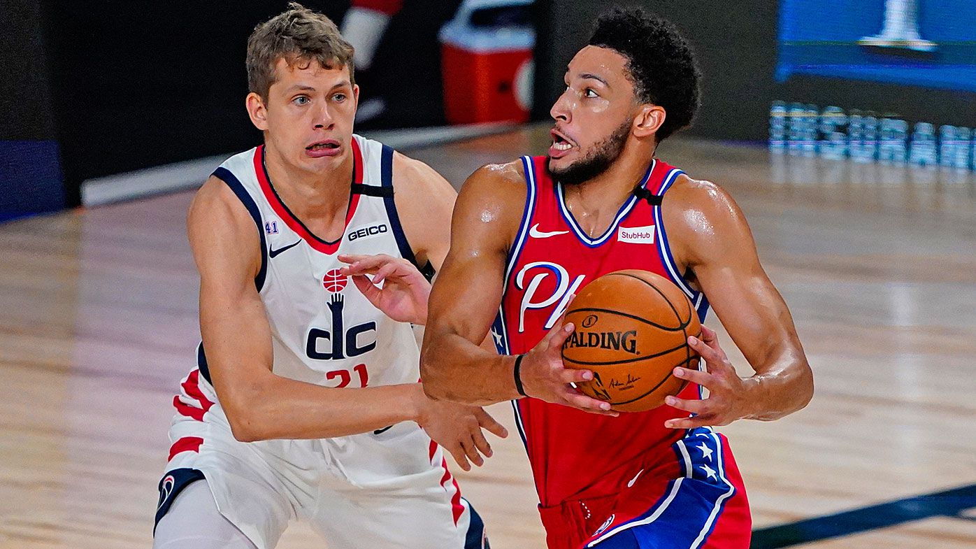 Ben Simmons #25 of the Philadelphia 76ers drives on Moritz Wagner #21 of the Washington Wizards