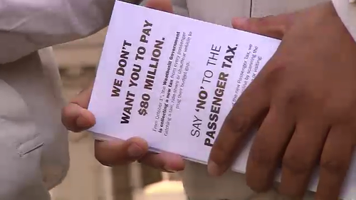 The United Taxi Association handed out flyers earlier today. (9NEWS)