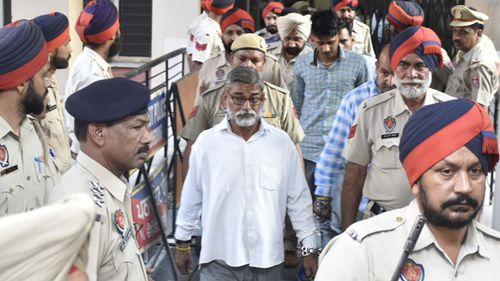 Sanji Ram, Tilak Raj and Parvesh Kumar, convicted in the Kathua rape and murder case, leave the District Court after it sentenced them to prison terms on June 10, 2019 in Pathankot, India.