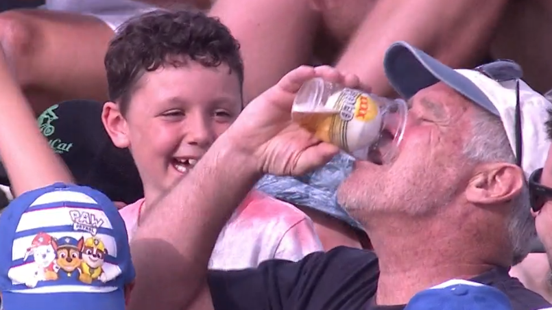 Big Bash League fan catches match ball in his beer cup, proceeds to neck beer