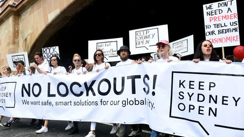 Demonstrators take part in protest rally against the NSW government's lockout laws and impact on nightlife in Sydney, Sunday, Feb. 21, 2016.