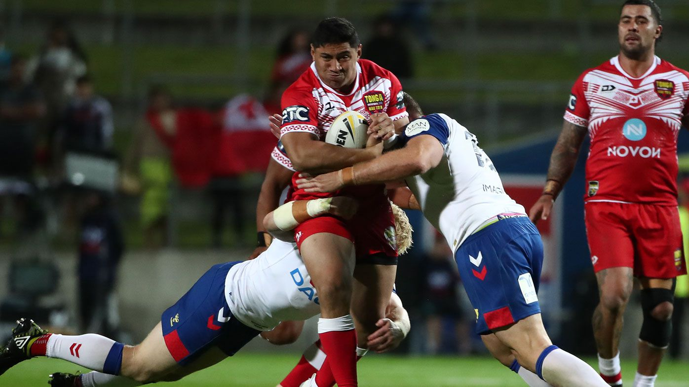 Jason Taumalolo captain of Tonga is tackled (C) during the International Rugby League Test match between the Great Britain Lions and Mate Ma'a Tonga