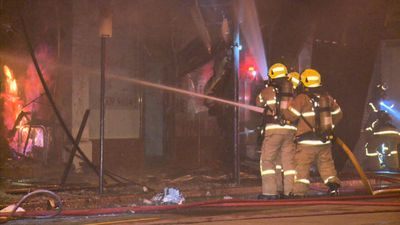 Restaurant gutted after fire tears through shopping strip