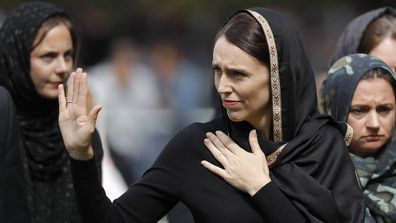 "New Zealand Prime Minister Jacinda Ardern waves as she leaves Friday prayers at Hagley Park in Christchurch, New Zealand. Ardern was hailed around the world for her decisive response to the two mosque shootings by a white nationalist who killed 50 worshippers in Christchurch mosques on 15 March 2019. Community leaders and researchers say that for too long, terrorism was considered a ""Muslim problem"" and that a double standard persists when attacker is white and non-Muslim."