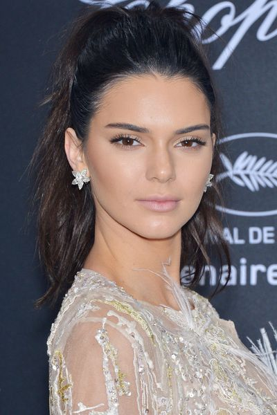 Winter dressing often lends itself to dark colours, layering and warmth over style. Looking fashion forward isn't always high on the list of priorities. If you're someone who's more into function than form, a new hairstyle is a simple yet effective way to add some interest to your ensemble. From Kendall Jenner's easy, messy ponytail to Rooney Mara's elaborate Oscars look, this hair inspo will have you looking well-heeled without sacrificing on comfort.