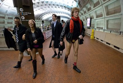 People stroll to a station in Washington DC minus their trousers.