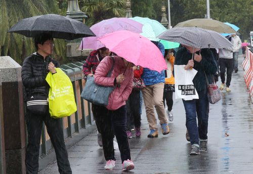 Don't forget your brolly if you're planning to be out and about in Melbourne tomorrow and Friday. (AAP)