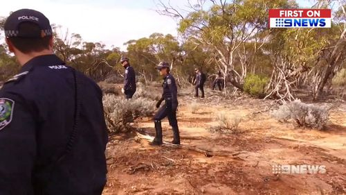 Detectives performed line searches in dense outback shrubbery in an attempt to find Redman.
