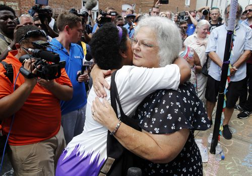 Mrs Bro is hugged by a well-wisher in Charlottesville. Picture: AP