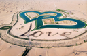 Heart shape man made lakes in the middle of Dubai desert in Al Qudra area aerial view