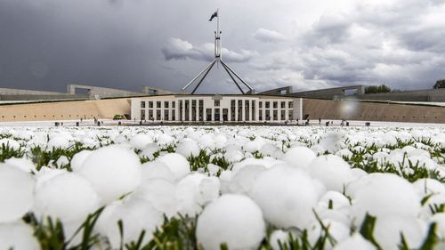 Parliament House at 12.59pm, captured by our Auspic photographer David Foote.