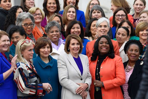 Nancy Pelosi poses for a photo with other female members of Congress.